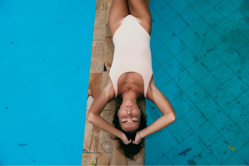 Woman with Beautiful Body Enjoys Pool Thanks to eon Non-Surgical Body Contouring Device